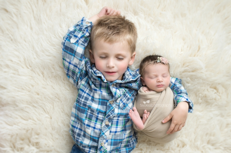 Although our newborn sessions are primarily focused on the baby we also include parent and sibling portraits with the baby at no additional charge